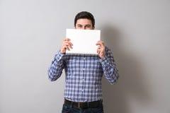 Homem com livro de texto Fotos de Stock