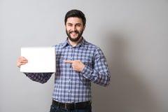 Homem com livro de texto Imagem de Stock Royalty Free