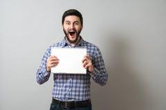 Homem com livro de texto Fotos de Stock Royalty Free