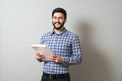 Homem com livro de texto Imagem de Stock