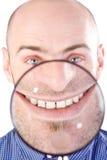 Homem com lupa Fotografia de Stock Royalty Free