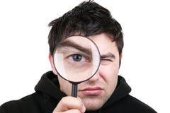 Homem com lupa Foto de Stock Royalty Free
