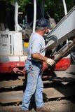 Homem com máquina escavadora Imagens de Stock Royalty Free