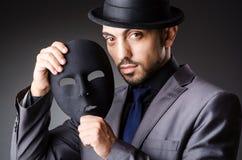 Homem com máscara fotografia de stock