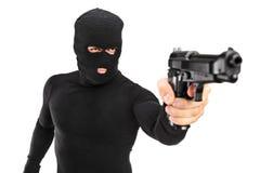 Homem com a máscara que prende um injetor Foto de Stock