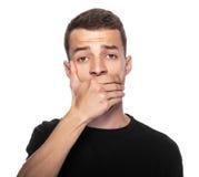 Homem com a mão que cobre sua boca fotos de stock