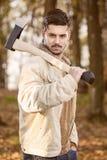 Homem com machado Imagens de Stock