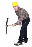Homem com machado da picareta fotografia de stock royalty free