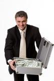Homem com a mala de viagem cheia do dinheiro Foto de Stock Royalty Free