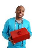 Homem com medida de fita e caixa de presente Imagens de Stock Royalty Free