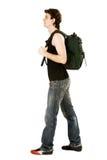 Homem com mochila verde Fotos de Stock