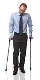 Homem com muleta Imagem de Stock Royalty Free