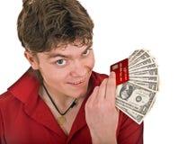 Homem com o cartão do dinheiro e de crédito. Imagem de Stock