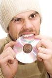 Homem com o chapéu que quebra o CD Fotografia de Stock Royalty Free