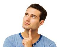 Homem com o dedo em Chin Looking Up Imagens de Stock