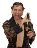 Homem com o katana no quimono fotos de stock