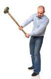 Homem com o martelo na ação Fotos de Stock