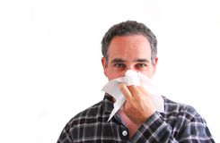 Homem com o nariz de sopro frio foto de stock royalty free