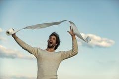 Homem com o papel higiênico feliz da posse da cara, único fotografia de stock royalty free