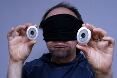 Homem com olhos fotografia de stock royalty free