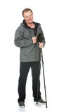 Homem com os polos de passeio do nordic Imagem de Stock