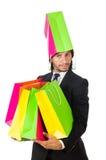 Homem com os sacos de compras isolados Fotos de Stock Royalty Free