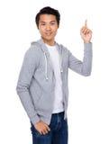 Homem com ponto do dedo acima Imagens de Stock