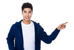 Homem com ponto do dedo acima Imagem de Stock Royalty Free