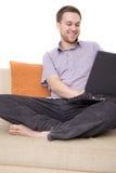Homem com portátil Imagem de Stock
