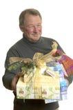 Homem com presentes Imagens de Stock