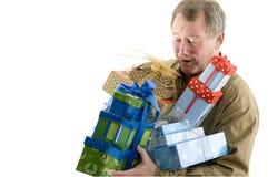 Homem com presentes dos presentes Foto de Stock Royalty Free
