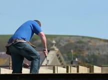 Homem com seu martelo Fotografia de Stock Royalty Free