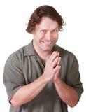 Homem com sorrir forçadamente mau imagem de stock