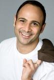 Homem com sorriso bonito no tshirt branco Fotos de Stock