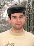 Homem com tampão preto Fotos de Stock Royalty Free