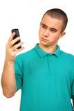 Homem com telefone de pilha Imagem de Stock