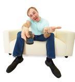 Homem com a tevê de controle remoto Imagens de Stock Royalty Free
