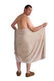 Homem com a toalha isolada no branco Fotografia de Stock Royalty Free