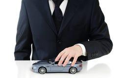 Homem com um carro do brinquedo Imagem de Stock Royalty Free