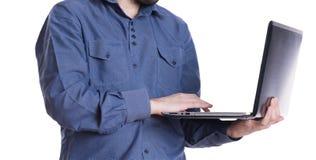 Homem com um portátil Imagem de Stock