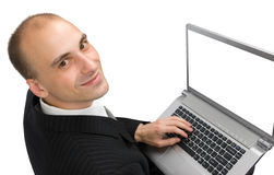 Homem com um portátil imagem de stock royalty free