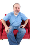 Homem com um telecontrole que fecha seus olhos na renúncia Foto de Stock Royalty Free