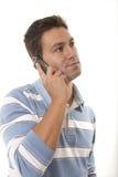 Homem com um telefone de pilha imagem de stock royalty free