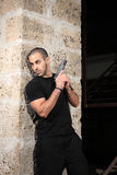 Homem com uma arma Imagem de Stock Royalty Free