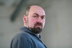 Homem com uma barba Imagens de Stock