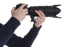 Homem com uma câmera de DSLR Imagem de Stock Royalty Free