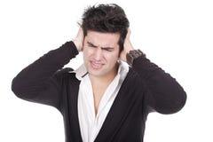 Homem com uma dor de cabeça Imagem de Stock Royalty Free