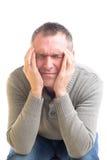 Homem com uma dor de cabeça Fotos de Stock