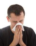 Homem com uma gripe Imagens de Stock