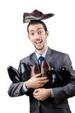 Homem com uma seleção das sapatas Fotos de Stock Royalty Free